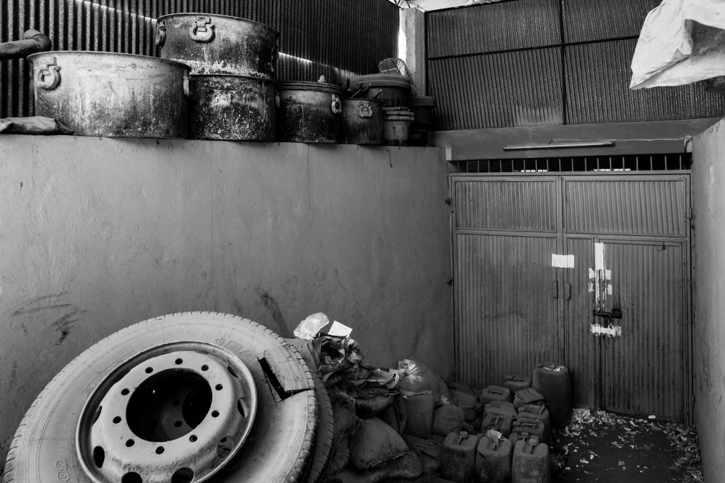 Cooking pots and chemicals used for heroin production, and a tyre used for smuggling lay in the Counter Narcotics Police headquarters. They will be used as evidence in future trials.