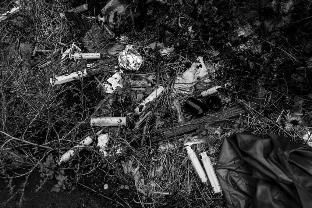 Used syringes are seen lying next to train tracks in a suburb of Sofia.